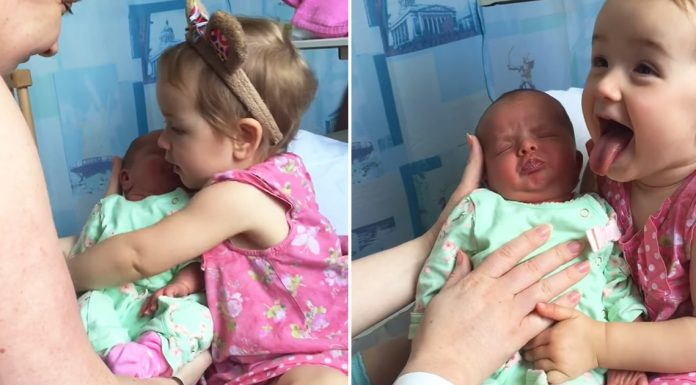 toddler holds baby