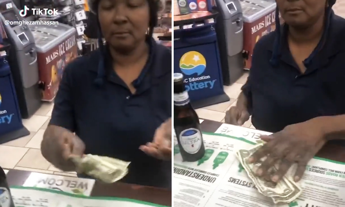 woman throws money to cashier