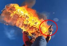 man-set own-parachute-on-fire