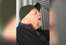 man-sings-in-shipping-container