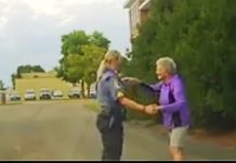cop-dance-with-elderly-in-road