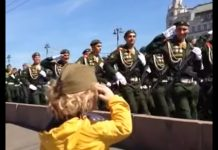little-girl-salutes-troops-v-day