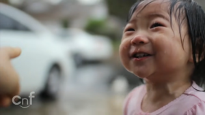 little-girl-experiences-rain-first-time1
