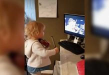 girl playing violin with tv